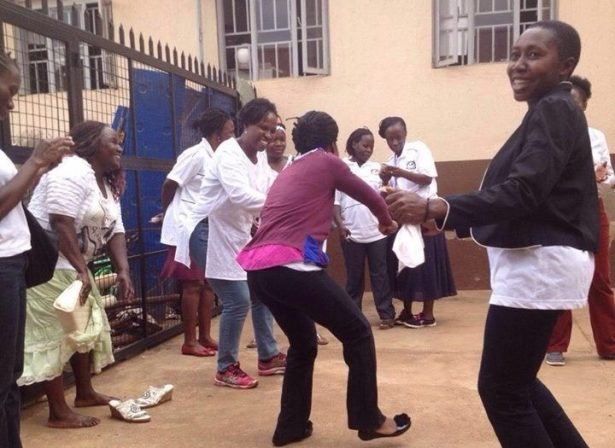 The arrested women break out in song and dance from within the police station. (WNV/Women's Movement)