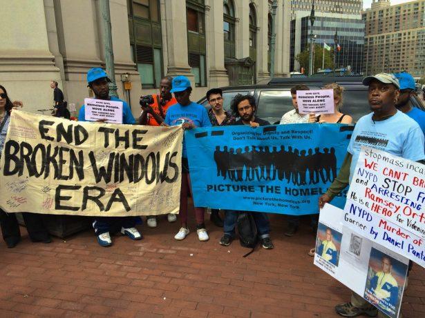 Activists outside NYPD commissioner Bill Bratton's farewell ceremony. (WNV/Ashoka Jegroo)