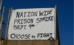 A banner drop in support of the upcoming nationwide prison strike appeared over the Lloyd Expressway in Evansville, Ohio last month. (Twitter / wheretheriverfrowns)