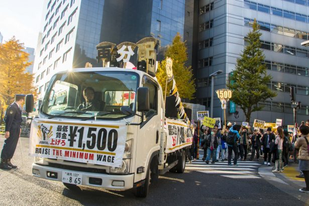 An Aequitas march Dec. 4 featured a pickup truck carrying speakers and a DJ. (Shinta Yabe)