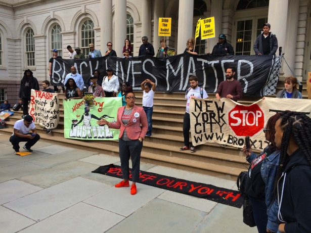 A rally to end police raids outside City Hall in New York