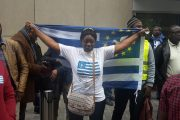 Woman carries the flag of Southern Cameroons at a protest in Brussels in March.