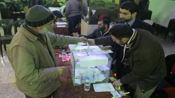 Man votes for local council at election center in Idlib City.