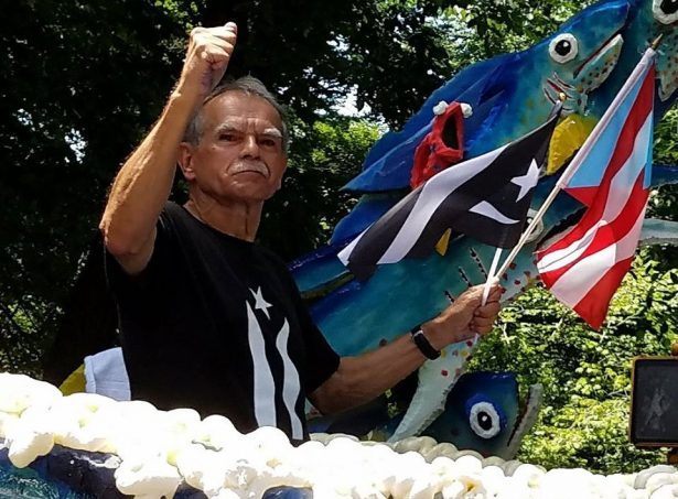 Oscar Lopez Rivera on a float at the parade.