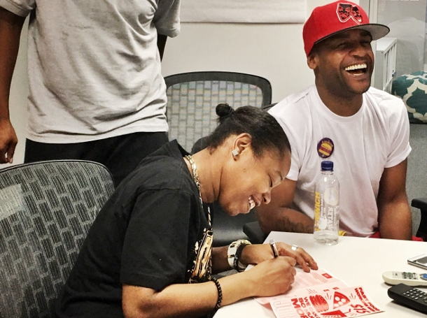 Shantel Walker signs card to join Fast Food Justice.