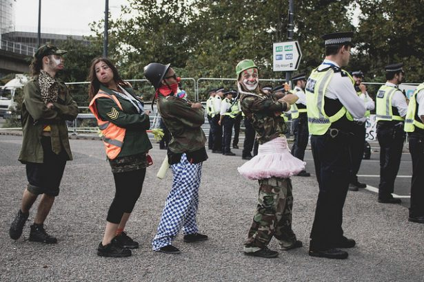 Clowns protest DSEI.