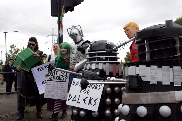 Super villains protest DSEI.