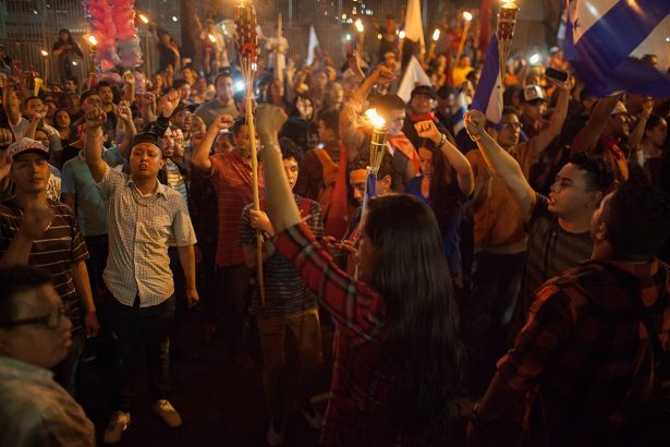 Youths chant with torches outside the U.S. embassy.