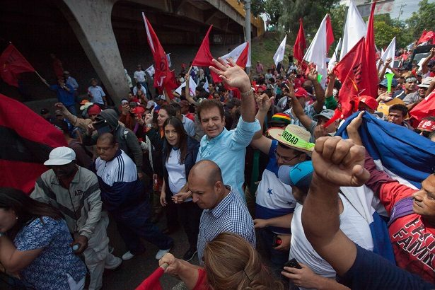 Salvador Nasralla marches with protesters