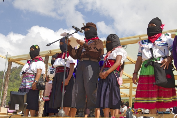 Zapatista women take the stage to deliver their speeches collectively from each Caracol, or administrative center. (Photo: WNV/Shirin Hess)